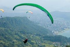 Paragliding over Pokhara, Nepal royalty free stock photography