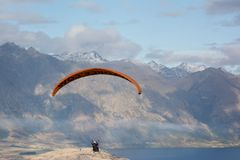 Paragliding over Queenstown, New Zealand. Taken from the top of the chair lift that overlooks the city of Queenstown, New Zealand. There are lots of outdoor Royalty Free Stock Photography