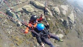 Paragliding over rocky mountain Royalty Free Stock Photos