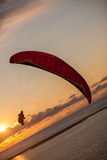 Paragliding over the sea Stock Photo
