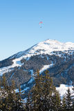 Paragliding over skiing area in the Austrian Alps Stock Images