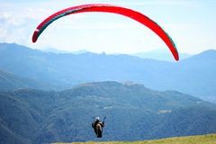 Paragliding over Swiss Alpes stock image
