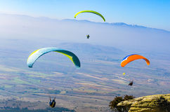 Paragliding over the tops of the mountains Stock Image