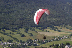 Paragliding over the village Stock Photo