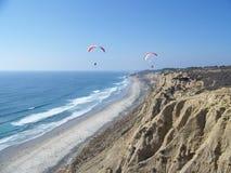 Paragliding the Pacific Coast. Above Blacks Beach Stock Photo