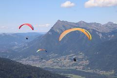Paragliding in Samoens, French Alps. Paragliding or parapente from the top of the mountain during the summer in Samoens and Morillon in the French Alps. Exciting royalty free stock image