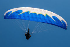 Paragliding. Is the recreational and competitive adventure sport of flying paragliders: lightweight, free-flying, foot-launched glider aircraft with no rigid Royalty Free Stock Photography