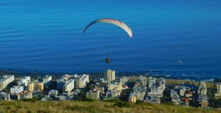 Paragliding from Signal Hill, Cape Town. A landscape view of para-gliders soaring above Mouille Point in Cape Town as seen from Signal Hill.  The Cape Town Stock Photos