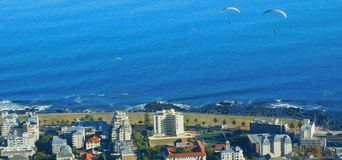 Paragliding from Signal Hill, Cape Town. A landscape view of para-gliders soaring above Mouille Point in Cape Town as seen from Signal Hill.  The Cape Town Stock Photo