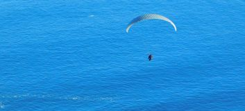 Paragliding from Signal Hill, Cape Town. A landscape view of para-gliders soaring above the sea at Mouille Point in Cape Town as seen from Signal Hill Stock Photo