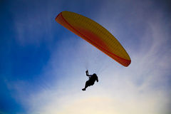 Paragliding Silhouette on blue sky Royalty Free Stock Images