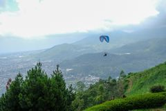 Paragliding in the sky of Batu, Indonesia. Sky racing by paragliding in Batu Malang, east java, Indonesia stock photo