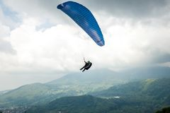 Paragliding in the sky of Batu, Indonesia. Sky racing by paragliding in Batu Malang, east java, Indonesia stock image