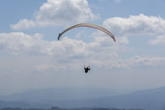 Paragliding in the sky. Royalty Free Stock Photography