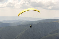 Paragliding in the sky. Stock Photo