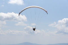 Paragliding in the sky. Royalty Free Stock Images