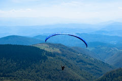 Paragliding sport with nice landscapes.  Royalty Free Stock Photos