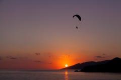 Paragliding at sunset in Oludeniz, Turkey Royalty Free Stock Photos
