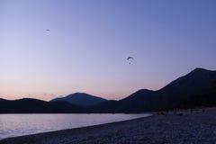 Paragliding at sunset in Oludeniz, Turkey Stock Image