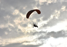 Paragliding on sunset,  silhouette of para-motor glider Royalty Free Stock Image