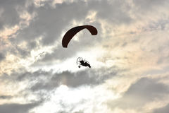 Paragliding on sunset,  silhouette of para-motor glider Stock Image