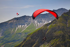 Paragliding in swiss alps Stock Photo