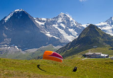 Paragliding in swiss alps Royalty Free Stock Photos