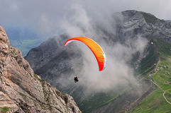 Paragliding in Swiss alps near Lucern, Switzerland royalty free stock image
