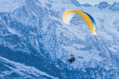 Paragliding in the Swiss Alps royalty free stock photo