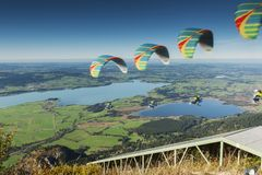 Paragliding on take-off sequence composing royalty free stock photo