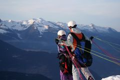 Paragliding in tandem. Two people leave the mountain so they can paraglide in the French mountains Stock Photo