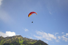 Paragliding. Tandem paragliding in in bright blue sky in Interlaken Switzerland Stock Photography