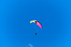 Paragliding in tandem with instructor. Paragliding is a popular summer sport atop Grouse Mountain in Vancouver, British Columbia, Canada Royalty Free Stock Photo