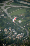 Paragliding top view. View from above, above the town, houses and roads Stock Image