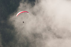 Paragliding top view, tandem. Paragliding top view, view from above, paragliding over the forest and clouds, two paragliders, tandem stock photo