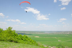 Paragliding in the valley at mountain Karatchoun.  Stock Image