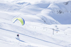 Paragliding in winter. Flight with the glider in German alps Royalty Free Stock Photography