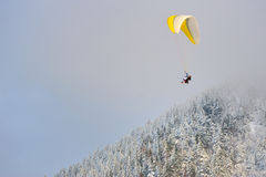 Paragliding in winter Royalty Free Stock Images