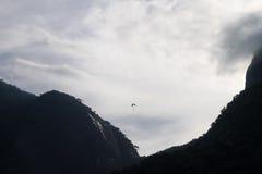 Paraglinder between Pedra da Gavea and Pedra Bonita mountains, R Royalty Free Stock Images