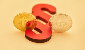 Paragraph with Bitcoin and Ether coin. As law and law in internet concept stock photography