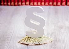 Paragraph symbol and american dollars in court library. Royalty Free Stock Photography