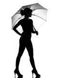 Paraguas abierto de la explotación agrícola de la mujer de la silueta Imagenes de archivo