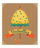 Paraguas amarillo con los corazones azules Imagenes de archivo