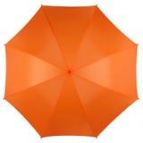 Paraguas anaranjado aislado en la visión blanca, superior Imagenes de archivo