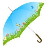 Paraguas azul con la hierba, las flores y las mariposas Imagen de archivo libre de regalías