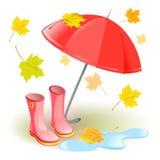 Paraguas, botas de goma, hojas de otoño Imagen de archivo libre de regalías