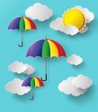 Paraguas coloridos que vuelan arriba en el aire Foto de archivo libre de regalías