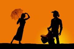 Paraguas de la mujer del vaquero de la silueta Imágenes de archivo libres de regalías