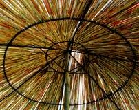 Paraguas de la paja Imagen de archivo libre de regalías
