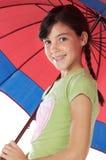 Paraguas de la pizca de la muchacha Foto de archivo